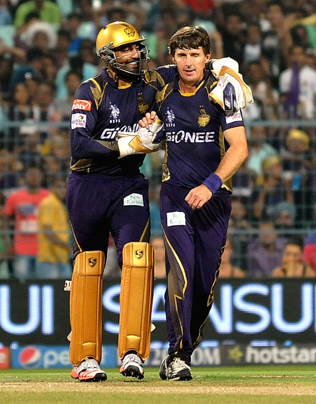 Kolkata Knight Riders bowler Brad Hogg and Robin Uthappa celebrate fall of a wicket during an IPL 2015 match between Kolkata Knight Riders and Sunrisers Hyderabad at the Eden Gardens in ... - Brad Hogg