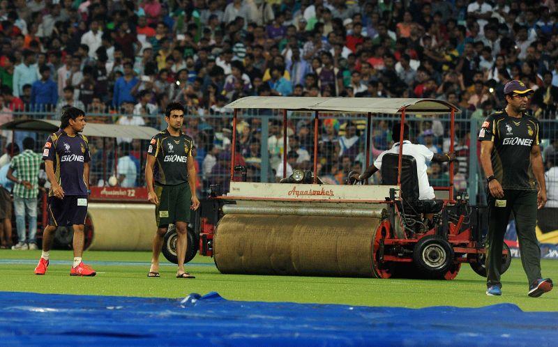 Kolkata Knight Riders bowling coach Wasim Akram, assistant coach Vijay Dahiya and captain Gautam Gambhir at the Eden Gardens after rains disrupted an IPL-2015 match between Kolkata ... - Gautam Gambhir