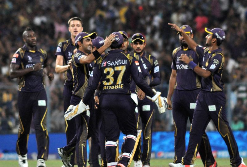 Kolkata Knight Riders (KKR) celebrate fall of a wicket during an IPL-2015 match between Kolkata Knight Riders (KKR) and Royal Challengers Bangalore (RCB) at Eden Gardens in Kolkata on April ...