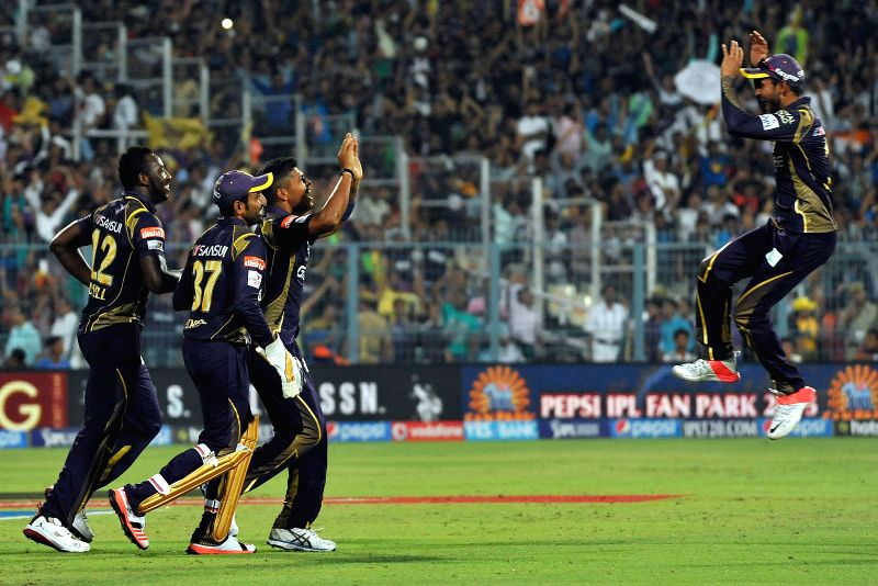 Kolkata Knight Riders (KKR) players Umesh Yadav, Andre Russell and Robin Uthappa celebrate fall of Aaron Finch's wicket during an IPL - 2015 match between Kolkata Knight Riders (KKR) and ... - Umesh Yadav