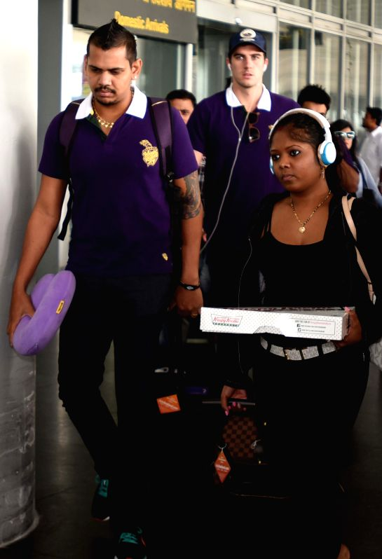 Kolkata Knight Riders players Sunil Narine and Pat Cummins arrives at Netaji Subhas Chandra Bose Airport in Kolkata on May 3, 2015.