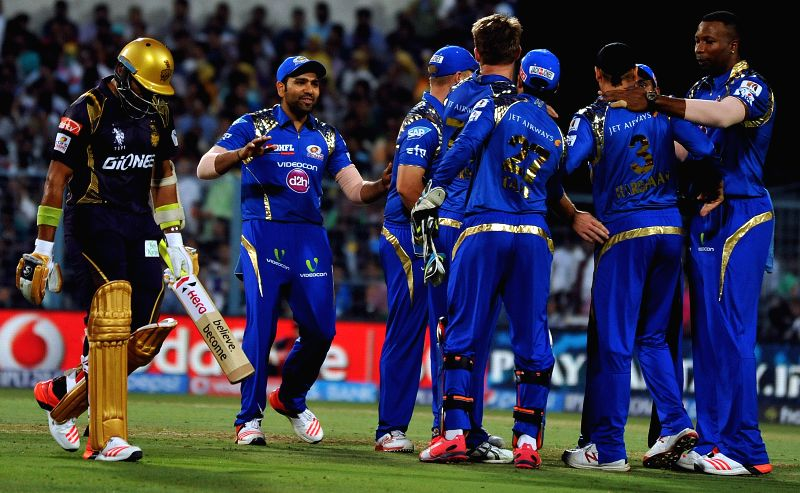 Kolkata: Mumbai Indians celebrate fall of Robin Uthappa's wicket during an IPL-2015 match between Kolkata Knight Riders and Mumbai Indians in Kolkata, on April 8, 2015.
