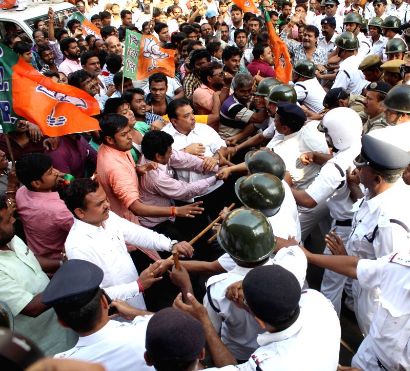Kolkata Police resorts to lathi charge to disperse BJP workers protesting against Kolkata Municipal Corporation (KMC) scams near KMC office in Kolkata, on March 11, 2015.