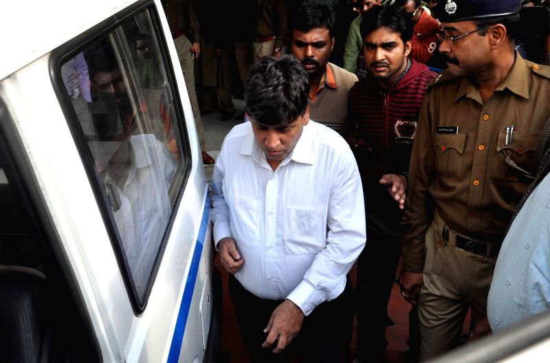 Lawyer Naresh Bhalotia being taken to be produced before a Kolkata court after being arrested by the CBI in connection with the multi-crore-rupee Sardha chit fund scam in Kolkata, on Dec 13,