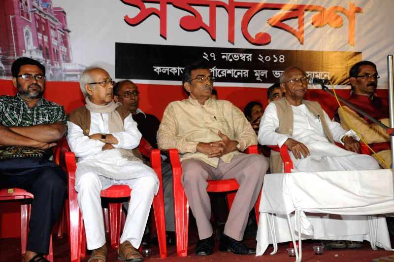 Leader of Opposition in West Bengal Legislative Assembly and CPI (M) leader Suryakanta Misra and other left leaders during a demonstration in front of KMC Office in Kolkata, on Nov 27, 2014.