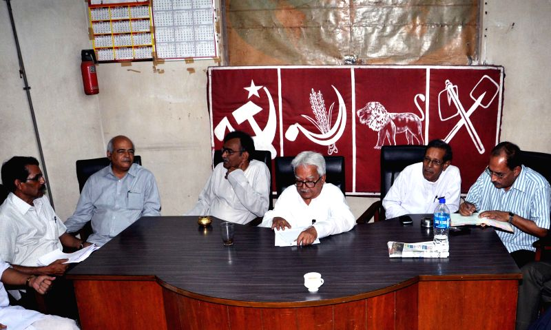 Left Front chairman Biman Bose and the leader of opposition in West Bengal Assembly, Communist Party of India-Marxist state secretary Surya Kanta Mishra and others during a meeting in ... - Biman Bose and Kanta Mishra