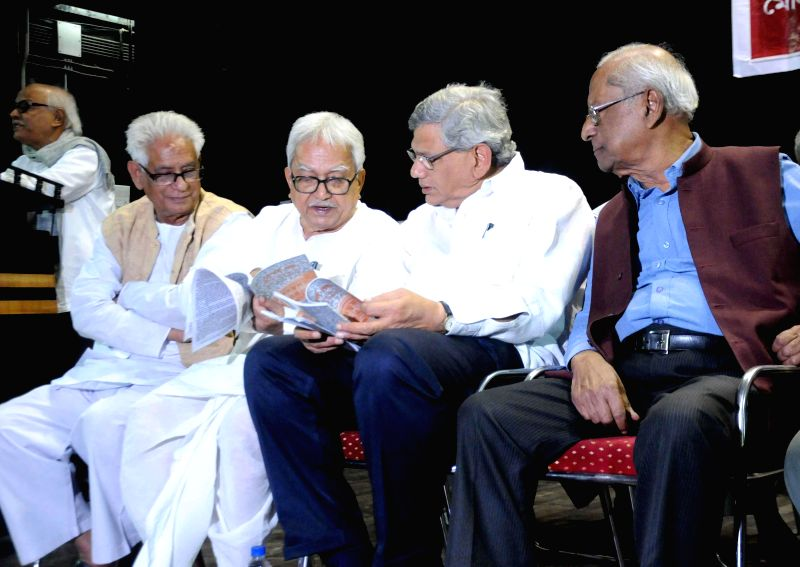 Left Front chairman Biman Bose, CPI (M) leader Sitaram Yechury, and CPI leader Ardhendu Bhushan Bardhan and others during a programme in Kolkata, on Nov 18, 2014. - Sitaram Yechury and Biman Bose