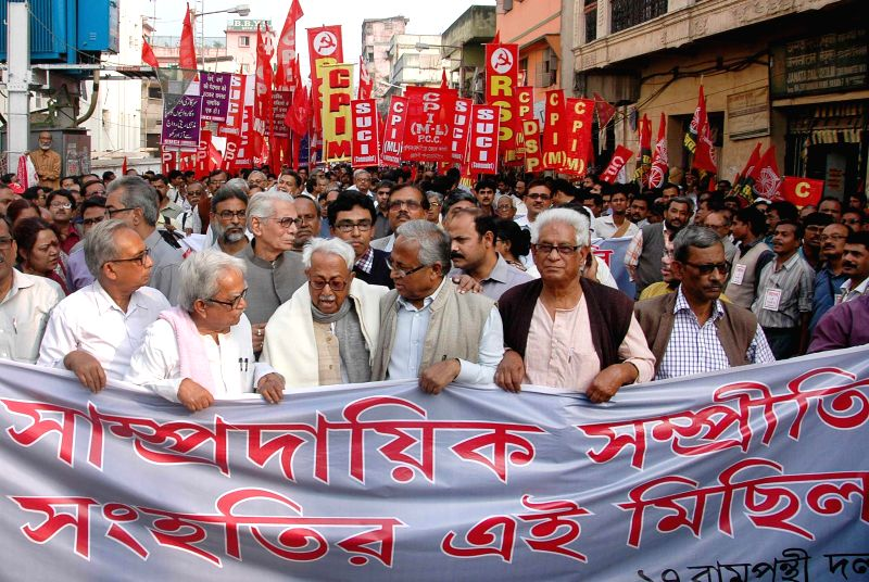 Left Front chairman Biman Bose, Forward Bloc leader Ashok Ghosh with others left leaders take part in a rally to mark the 22nd anniversary of the demolition of Babri Masjid in Kolkata on ... - Biman Bose and Ashok Ghosh