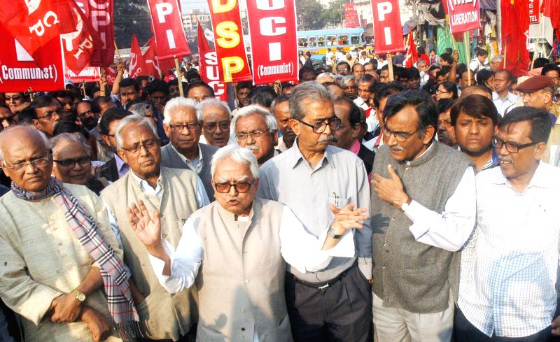 Left Front chairman Biman Bose, Leader of Opposition in the West Bengal Assembly Surya Kanta Misra, CPI state secretary Manju Kumar Majumder and other leaders take part in a protest rally in - Biman Bose and Manju Kumar Majumder