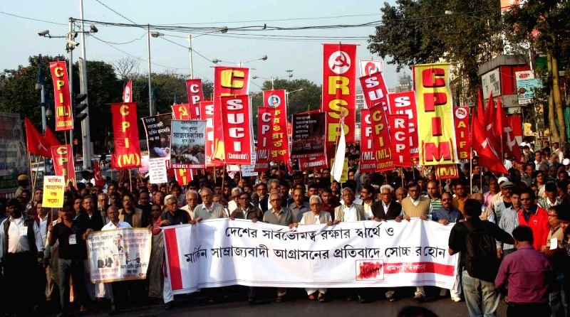 Left Front Chairman Biman Bose with activists participate in rally in Kolkata against US President Barack Obama's visit in India on Jan 24, 2015. - Biman Bose