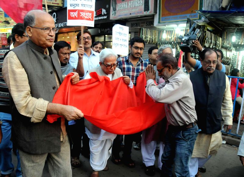 Left front leaders led by their chairman Biman Bose collect funds for the victims of recent Assam violence at New Market area in Kolkata, on Jan 4, 2015. - Biman Bose