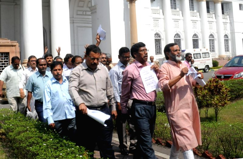 Left MLAs walk out of West Bengal Legislative Assembly to protest against the state government in Kolkata, on Feb 24, 2015.