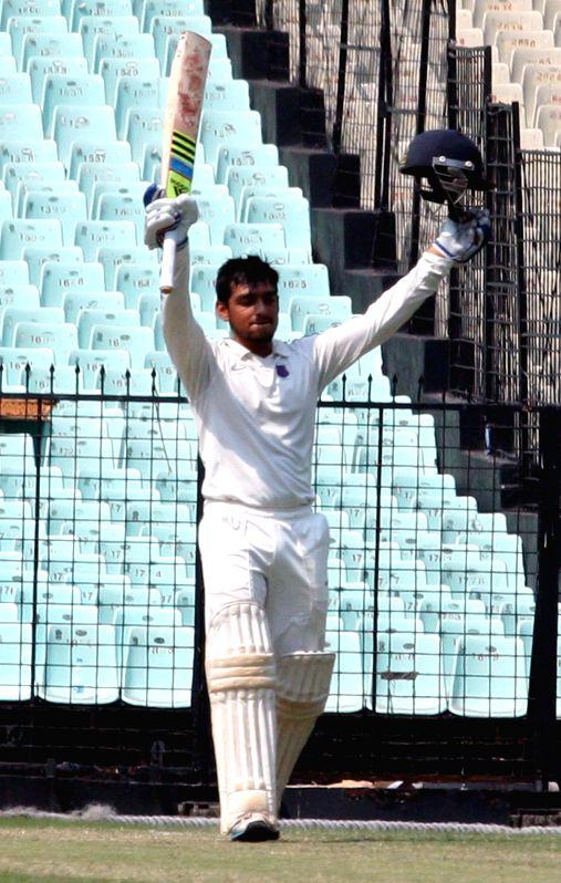 Maharashtra batsman Chirag Khurana celebrates his century during a Ranji Trophy Semi Final match between Tamil Nadu and Maharashtra at Eden Gardens in Kolkata on Feb 28, 2015. - Chirag Khurana