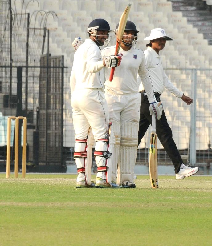 Maharashtra batsman Swapnil Gugale celebrates his half century during a Ranji Trophy Semi Final match between Tamil Nadu and Maharashtra at Eden Gardens in Kolkata on Feb 27, 2015. (Photo: ... - Swapnil Gugale