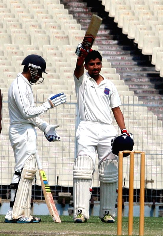 Maharashtra batsman Swapnil Gugale celebrates his century during a Ranji Trophy Semi Final match between Tamil Nadu and Maharashtra at Eden Gardens in Kolkata on Feb 28, 2015. - Swapnil Gugale