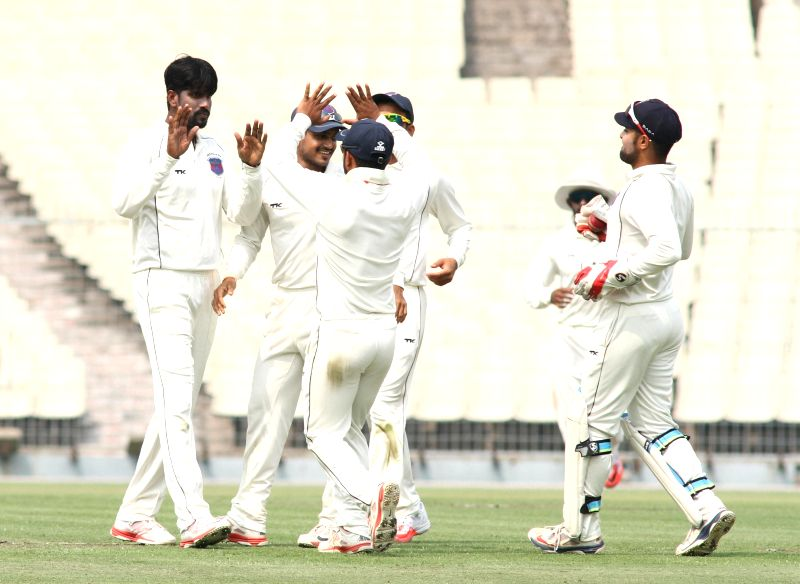 Maharashtra players celebrate fall of a wicket during a Ranji Trophy Semi Final match between Tamil Nadu and Maharashtra at Eden Gardens in Kolkata on Feb 25,2015.