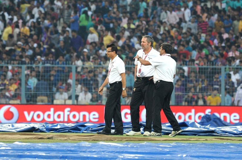 Match officials inspect the ​field ​at the Eden Gardens after rains disrupted an IPL-2015 match between Kolkata Knight Riders (KKR) and Rajasthan Royals (RR) in Kolkata on April 26, ...