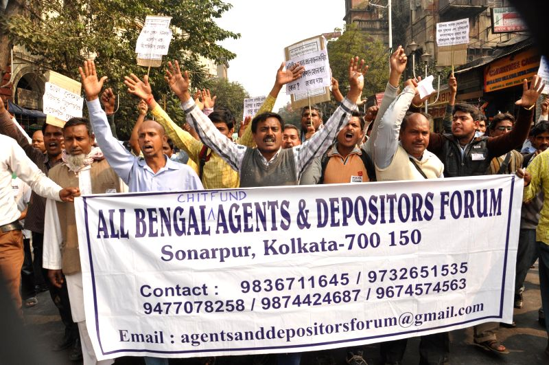 Member of Chit Fund Agents and Depositors Forum take part in a protest rally against West Bengal Government in Kolkata on Jan 29, 2015.