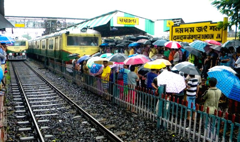 : Kolkata: Members of All India Matua Mahasangha stage a demonstration on railway tracks at Dumdum station near Kolkata in West Bengal in protest against the exclusion of 40 lakh people from ...
