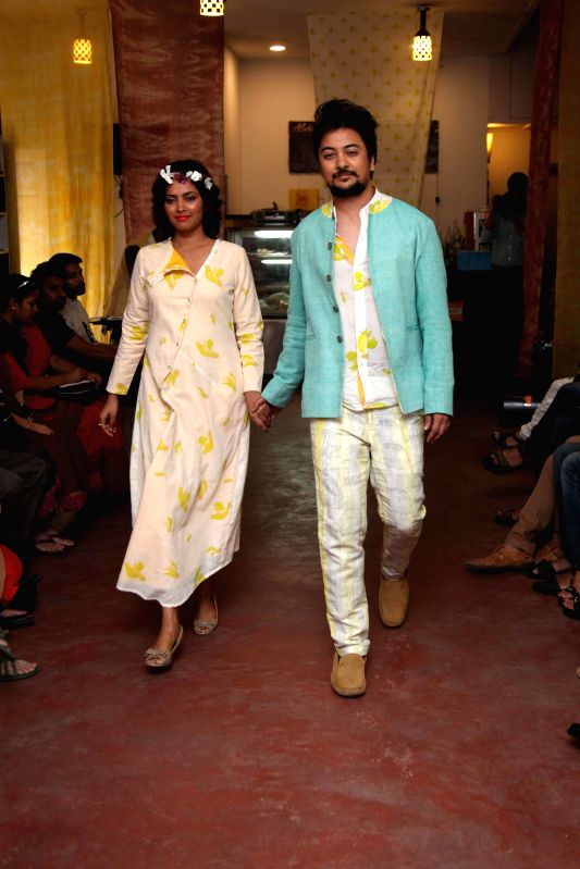 Models walk the ramp during a fashion show in Kolkata, on March 8, 2015.