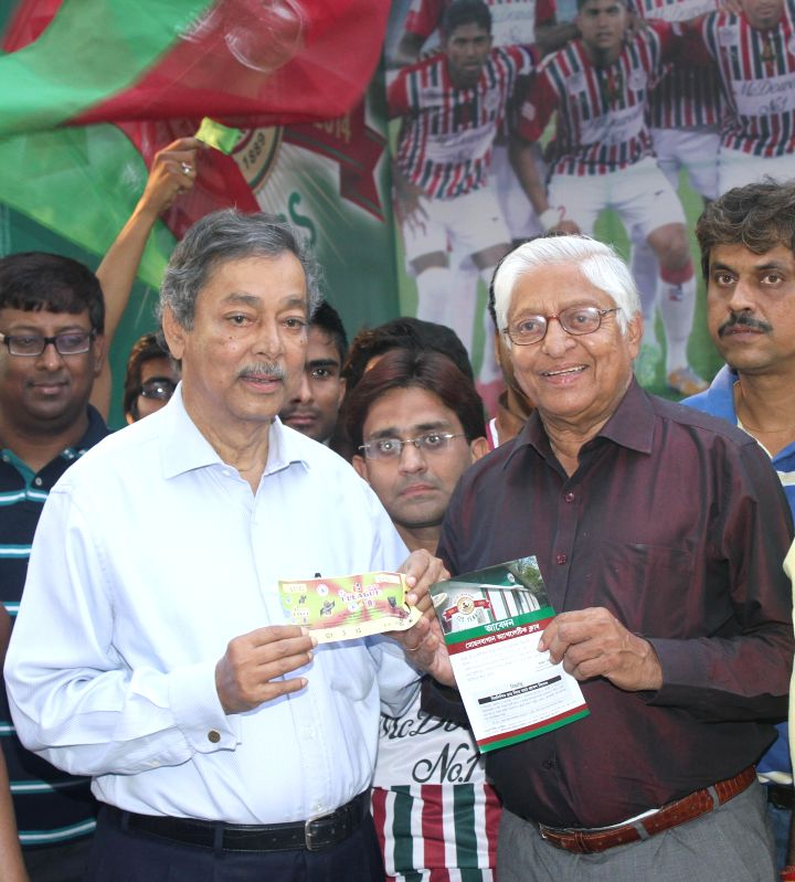 Mohun Bagan official Anjan Mitra and veteran footballer Chuni Goswami during a programme organised to flag-off an I-League campaign vehicle in Kolkata on March 24, 2015. - Chuni Goswami