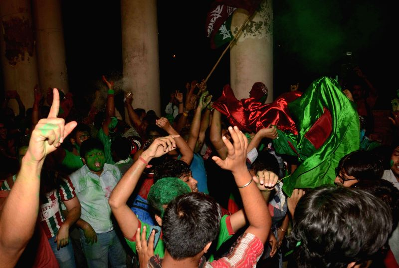 Mohun Bagan supporters celebrate team's victory in the final I-League match against Bengaluru FC; in Kolkata, on May 31, 2015.