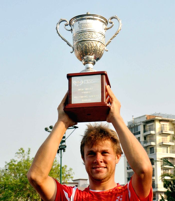 Moldova tennis player Radu Albot celebrates with the winner's trophy after winning the Emami Kolkata Open 2015- ATP Challenger final in Kolkata on Feb 28, 2015.