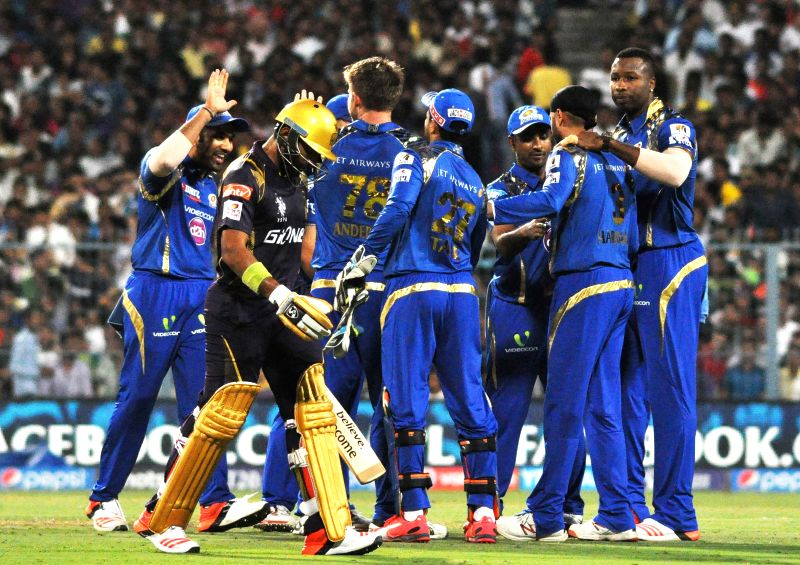 Mumbai Indians celebrate Robin Uthappa's wicket during an IPL-2015 match between Kolkata Knight Riders and Mumbai Indians in Kolkata, on April 8, 2015.