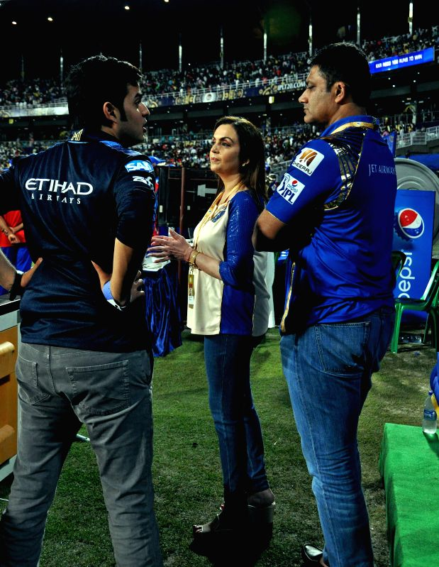 Mumbai Indians co-owner Nita Ambani with Akash Ambani and Anil Kumble during an IPL-2015 match between Kolkata Knight Riders and Mumbai Indians in Kolkata, on April 8, 2015.  - Nita Ambani and Akash Ambani