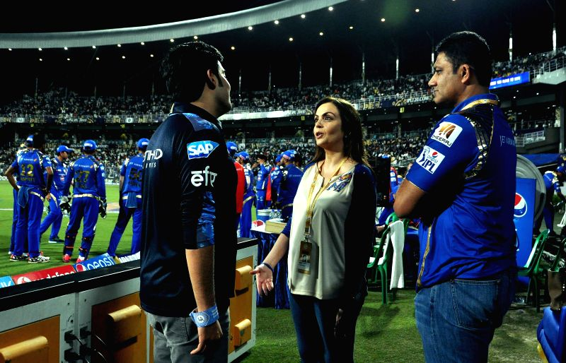 Mumbai Indians co-owner Nita Ambani with Akash Ambani and Anil Kumble during an IPL-2015 match between Kolkata Knight Riders and Mumbai Indians in Kolkata, on April 8, 2015. ​ - Nita Ambani and Akash Ambani