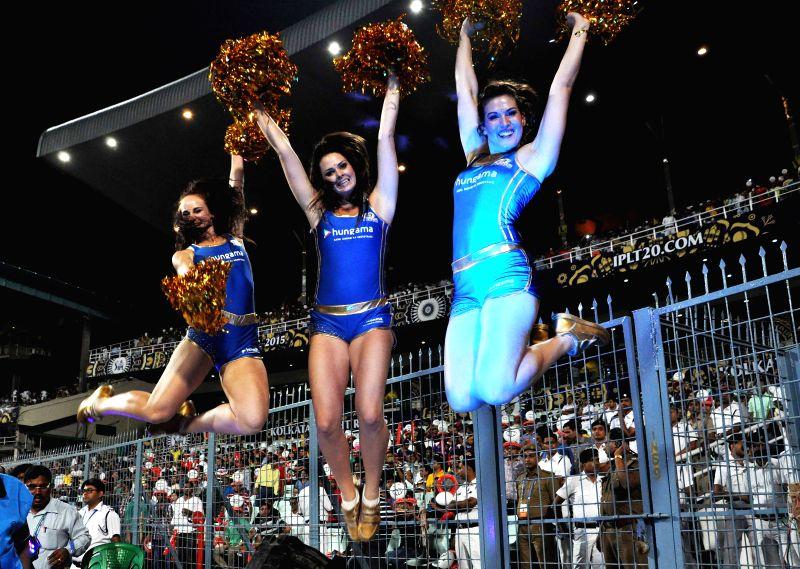 Mumbai Indians (MI) cheer leaders perform during an IPL-2015 match between Kolkata Knight Riders (KKR) and Mumbai Indians (MI) at the Eden Gardens in Kolkata on April 8, 2015.