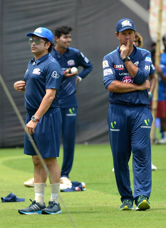 Mumbai Indians (MI) head coach Ricky Ponting with MI team icon Sachin Tendulkar during a practice session at the Eden Gardens in Kolkata, on April 7, 2015. - Sachin Tendulkar