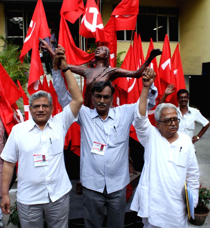 Newly elected CPI(M) West Bengal secretary Surjya Kanta Mishra outside the Pramod Dasgupta Bhavan during the CPI(M)'s 24th West Bengal State Conference in Kolkata. Also seen CPI(M) general ... - Surjya Kanta Mishra and Biman Bose