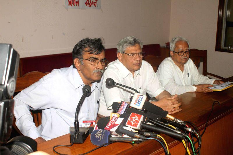 Newly elected CPI(M) West Bengal secretary Surjya Kanta Mishra addresses a press conference during the CPI(M)'s 24th West Bengal State Conference at Pramod Dasgupta Bhavan in Kolkata. Also ... - Surjya Kanta Mishra and Biman Bose