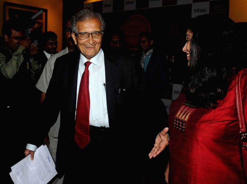 Nobel laureate Amartya Sen and Infosys co-founder N.R. Narayana Murthy and the jury members of Infosys Award 2014 at an award distribution ceremony in Kolkata on Jan. 5, 2014.