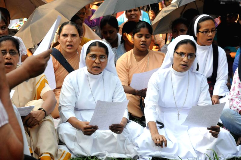 Nuns pray pray for the nun who was gang raped in Ranaghat of West Bengal, outside the Allen Park in Kolkata  on March 16, 2015.