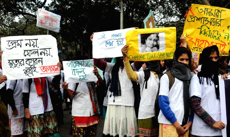Nurses participate in a silent rally against the death of a nurses at Burdwan Medical College, at Esplanade in Kolkata on Dec 12, 2014.