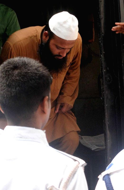 One of the accused in Burdwan blast being taken to be produced in front of a Kolkata court on March 27, 2015.
