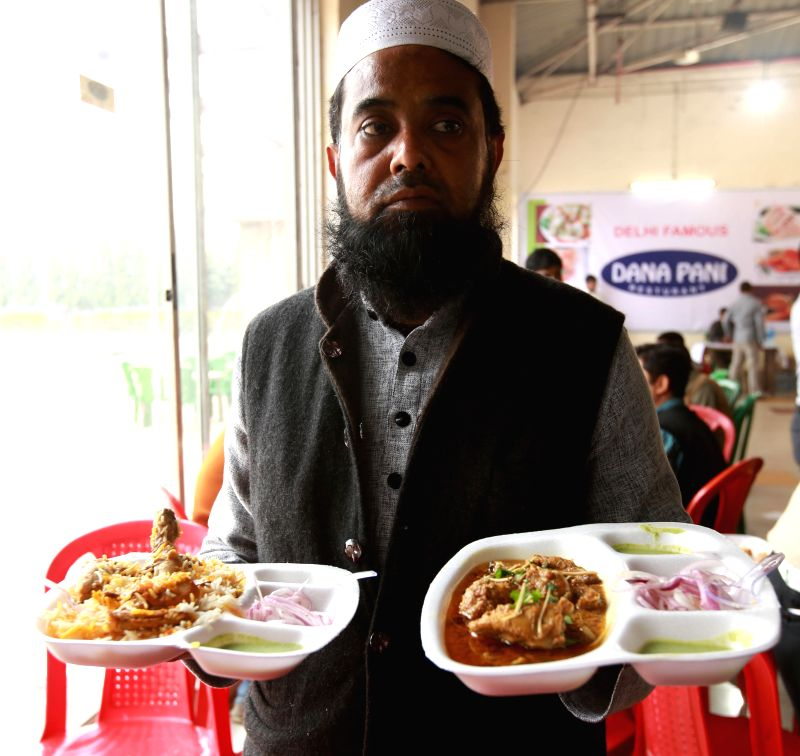 "Pakistani Head Chef Md. Arif prepares chicken kababs during the "" Taste of Reunion "" at 27th Industrial India Trade fair in Kolkata, on Dec 30, 2014."
