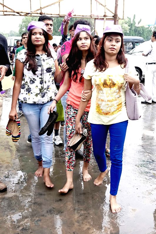 People arrive at the Eden Gardens to watch an IPL-2015 match between Kolkata Knight Riders and Rajasthan Royals in Kolkata on April 26, 2015.