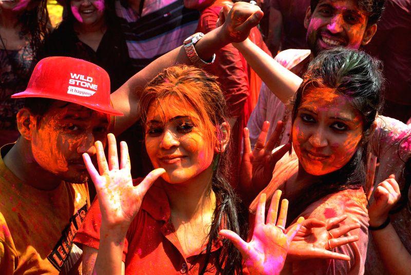 People celebrate holi during `Rangotsav 2015` in Kolkata on March 6, 2015.