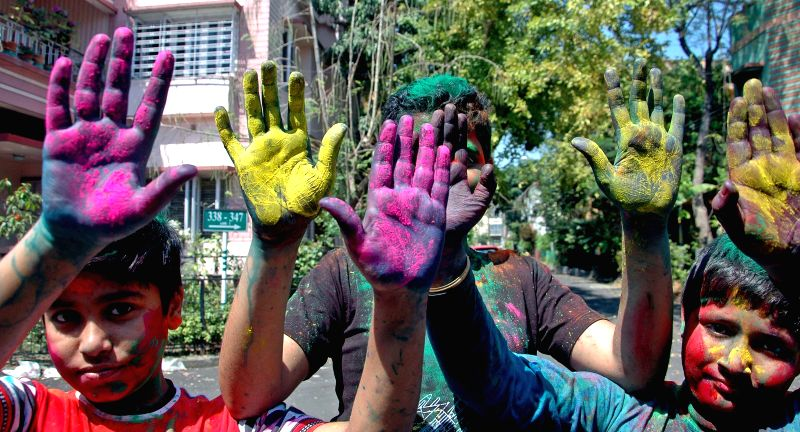 People celebrate Holi in Kolkata, on March 5, 2015.