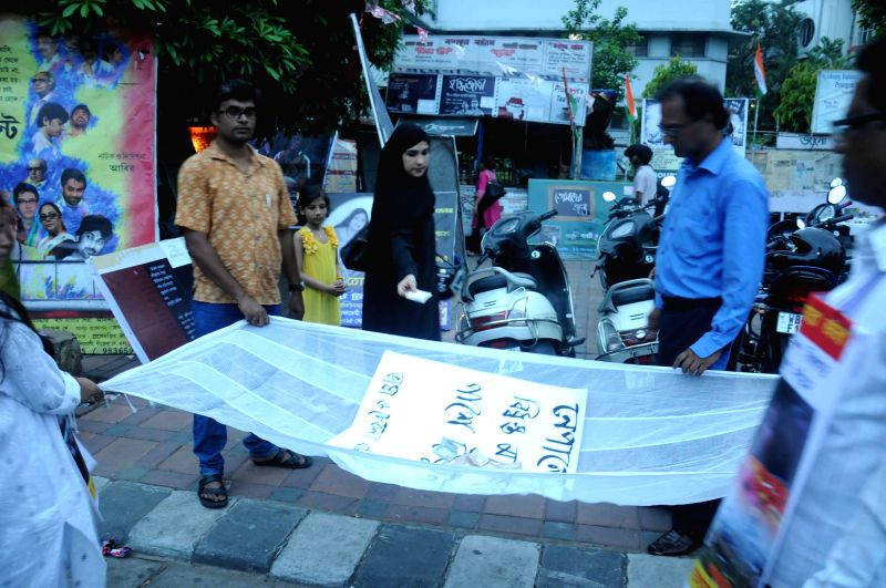 People collect donations for the victims of Nepal earthquake, in Kolkata, on May 3, 2015.