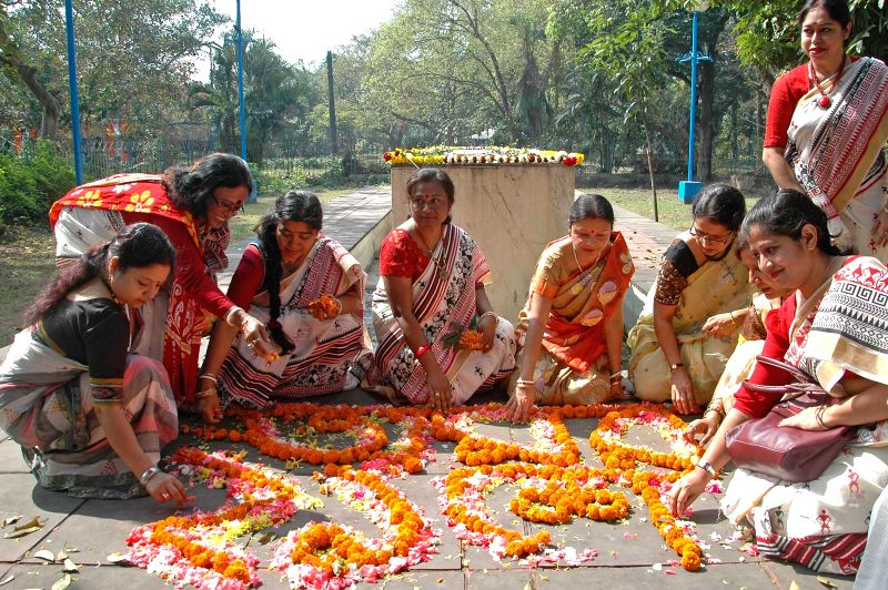 People decorate the martyr`s column to mark International Mother Language Day in Kolkata on Feb 21, 2015.