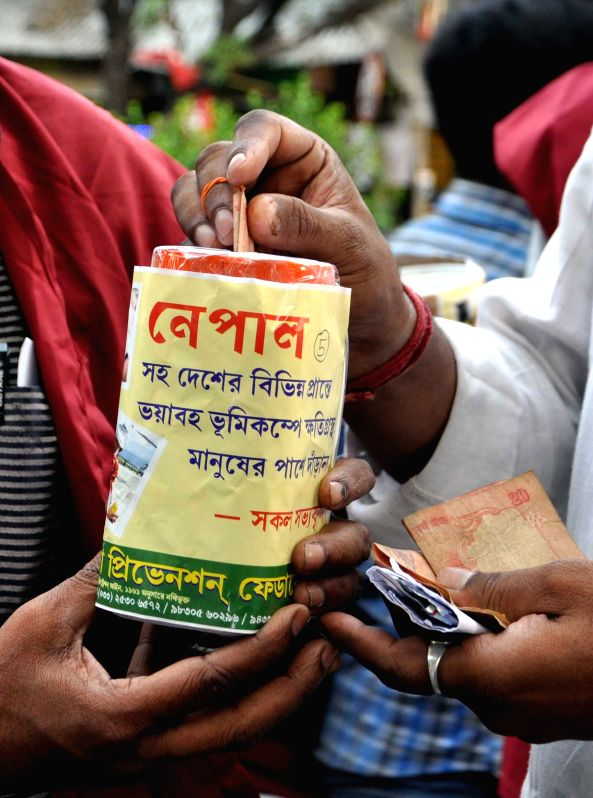 People donate money for Nepal earthquake victims in Kolkata, on April 29, 2015.