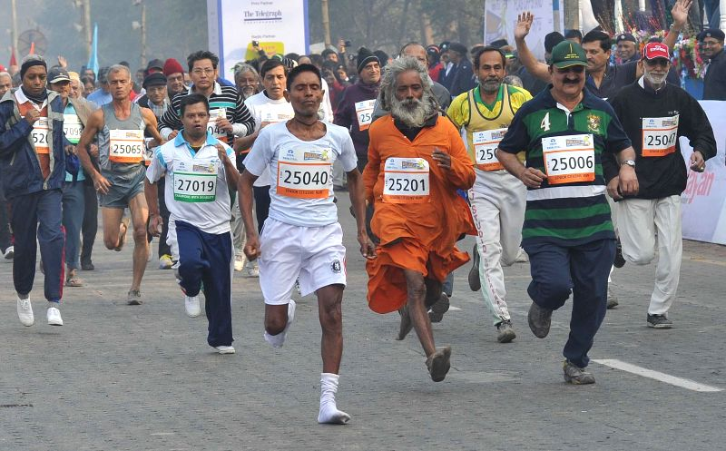 People participate in 25K Kolkata Marathon on Dec 28, 2014.