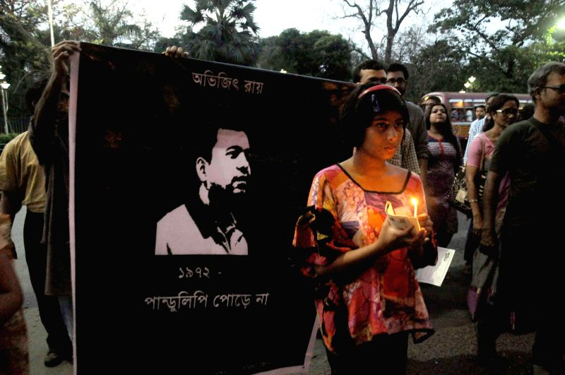 People participate in a candlelight vigil to pay tribute to Avijit Roy - a prominent American blogger of Bangladeshi origin, who was hacked to death in Dhaka; in Kolkata, on March 1, 2015.
