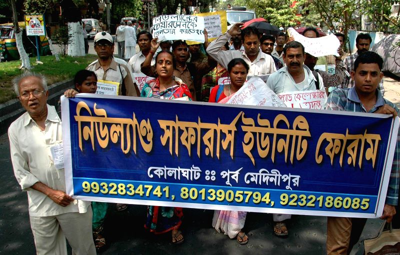 People participate in a demonstration organised by Chit Fund Sufferer's Unity Forum in Kolkata, on March 16, 2015.