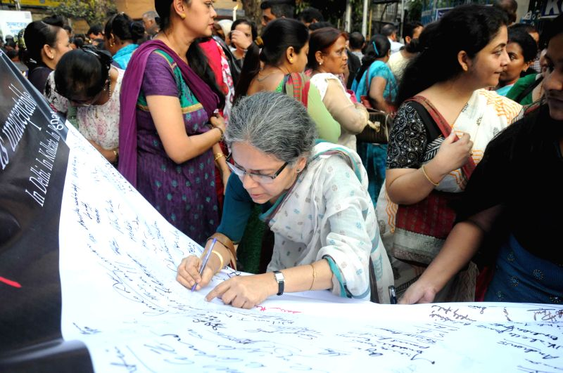 People participate in a demonstration to protest against the  gang rape of a nun in Ranaghat of West Bengal, outside the Allen Park in Kolkata  on March 16, 2015.