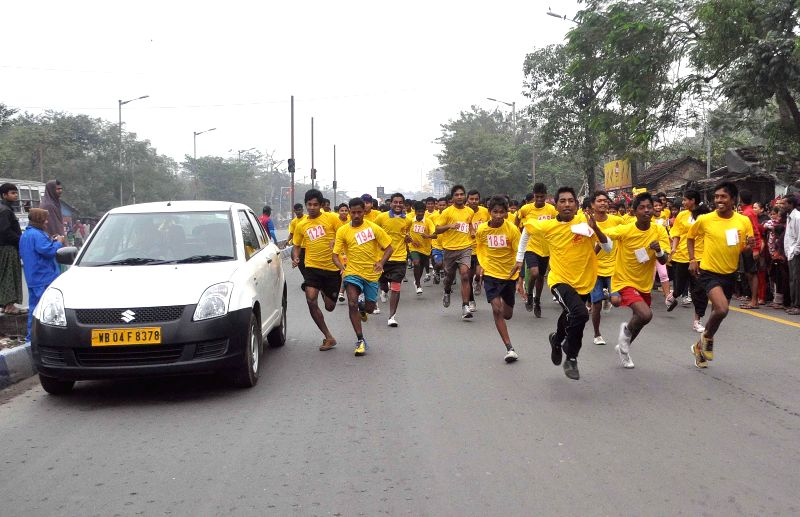 People participate in a marathon organised to protest against the recent attack on a Peshawar school in Pakistan, that claimed 148 lives, mostly children,in Kolkata, on Jan 4, 2015.